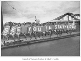 Women holding 'See You in Seattle' signs, Seattle World's Fair, ca. 1961