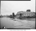 Olympic champion crew team from University of Washington rowing near shellhouse, Seattle, June 20,...