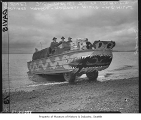 Amphibious vehicle carrying newspapers, Seattle, March 1, 1948