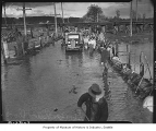 Men sandbagging during Green River flood, Kent, April 1938