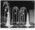 U.S. Science Pavilion arches at night, Seattle World's Fair, 1962