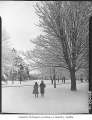 Girls walking in snow in Woodland Park, Seattle, 1948