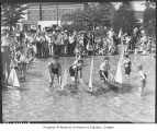 Boys sailing boats in Green Lake wading pool, Seattle, Summer 1934