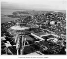 Aerial of Space Needle and fairgrounds during construction from southeast, Seattle World's Fair,...