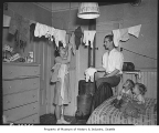 Acor family in crowded apartment, Seattle, ca. 1940