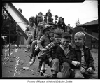 Children on slide at Seattle Day Nursery, Seattle, 1942