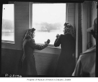 Ritsuko Terayama and Sumiko Furuta at window of ferry crossing Puget Sound, 1942
