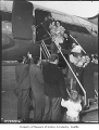 War brides and children disembarking from plane, probably in Seattle, 1950