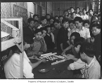 Chinese boys playing mah jong at Immigration Station, Seattle, 1938