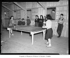 Internees playing table tennis at Camp Harmony, Puyallup, 1942