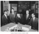 Architects and others with model of U.S. Science Pavilion, Seattle World's Fair, ca. 1961