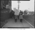 Woman and children picketing outside Armory during Canwell hearings, Seattle, 1949