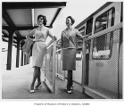 Loxi Williams and Sharon Brooks at monorail station, Seattle World's Fair, 1962
