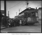 Children boarding Wallingford streetcar on its last run, Seattle, 1940
