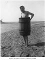 Carl Henry Moen in barrel on beach at Salmon Bay, Seattle, ca. 1910