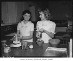 Harriet Lind and Dianne Sullivan in home economics class at Meany School, Seattle, 1948