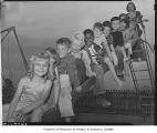 Children on slide at Yesler Terrace playground, Seattle, 1942