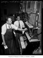 Ralph Riley and Alex Buchaltz working inside Rainier Brewery, Seattle, 1949