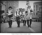 Four men marching in Independence Day parade, Seattle, July 4, 1938