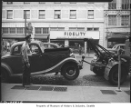 Tow truck impounding illegally parked car, Seattle, October 6, 1942