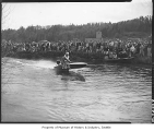 Motorboat in race on Sammamish Slough, Redmond, 1952