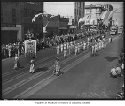 Chinese community marchers in Potlatch parade on Second Avenue, Seattle, 1938