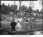 Member of Eastgate Baptist Church being baptized in lake, Seattle, 1957