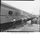 Men washing exterior of railroad car, 1947