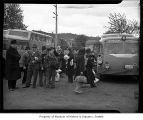 Internees arriving on buses at Camp Harmony, Puyallup, 1942