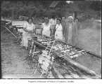 Women cooking salmon on Muckleshoot Reservation, Auburn, ca. 1950