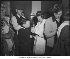 James LaDuke receiving smallpox vaccination from nurse Victoria Penlick, Seattle, 1946