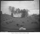 Army guns at civil defense demonstration in Husky Stadium, Seattle, 1943