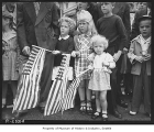 Children with flags watching Independence Day parade, Seattle, July 4, 1947