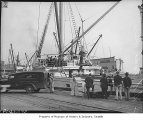 North Star at dock loading supplies for Arctic expedition, Seattle, 1939