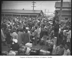 Japanese American internees preparing to leave Camp Harmony for internment camps, Puyallup, 1942