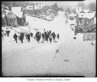 Children pulling sleds up Eleventh East hill in Roanoke neighborhood, Seattle, 1937