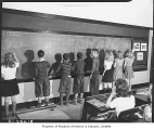 Students writing on chalkboard at Magnolia School, Seattle, February 1942