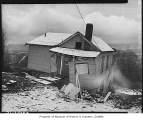 House damaged by landslide, Seattle, 1950