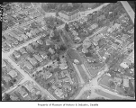 Aerial of sewer break damage looking northwest, Seattle, 1957