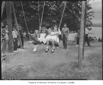 Children on swing at Swedish picnic, Bellevue, 1949