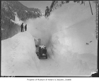 Snowplow clearing avalanche at Snoqualmie Pass, 1936