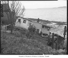 House damaged by landslide, Seattle, February 26, 1948