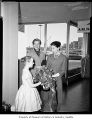 Ballet stars Margot Fonteyn and Rudolph Nureyev being handed a bouquet by Francesca Corkle at...