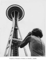 Shirley Farnham taking photo of Space Needle, Seattle World's Fair, 1962