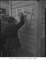 Soldier posting Civilian Exclusion Order, Bainbridge Island, 1942