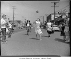 Pancake flipping race at Pancake Festival, White Center, 1956