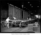 Men assembling a railroad car at Pacific Car and Foundry factory, Renton, August 1941