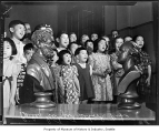 Bailey Gatzert School students singing near statues of Lincoln and Washington, Seattle, 1941