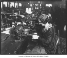 Woman sewing at Black Manufacturing Co., Seattle, ca. 1927