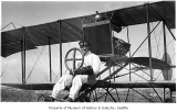 Herb Munter in airplane, Seattle, ca. 1915